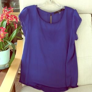 Royal blue tulip sleeve blouse with flowered trim